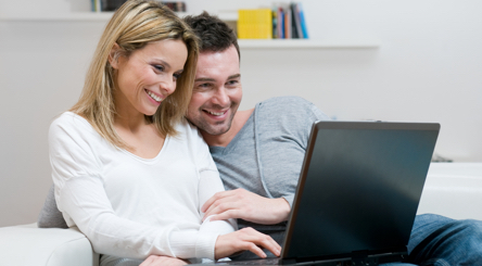 Couple happy backing up their files
